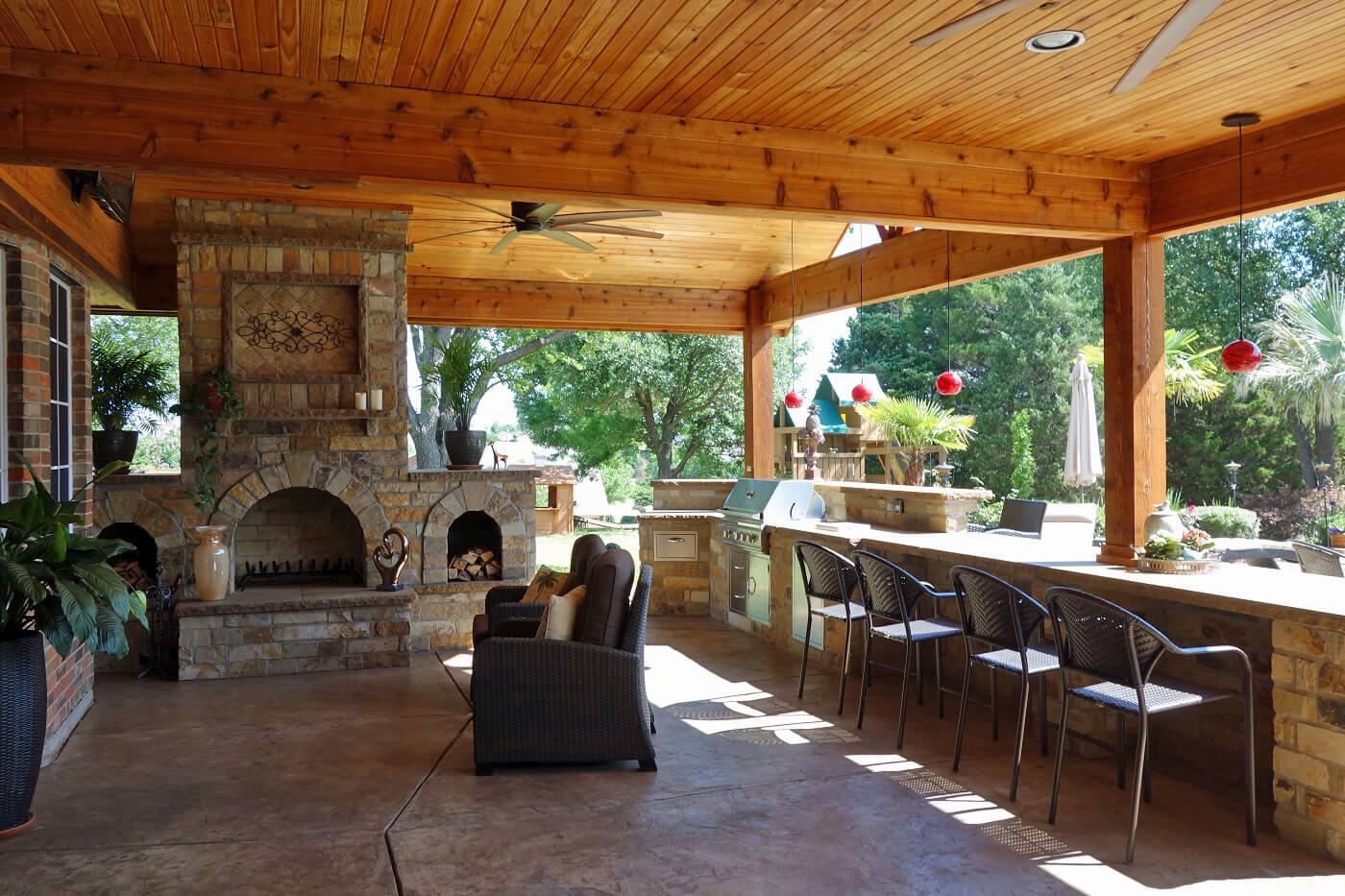 Custom covered patio with bar counter and outdoor fireplace